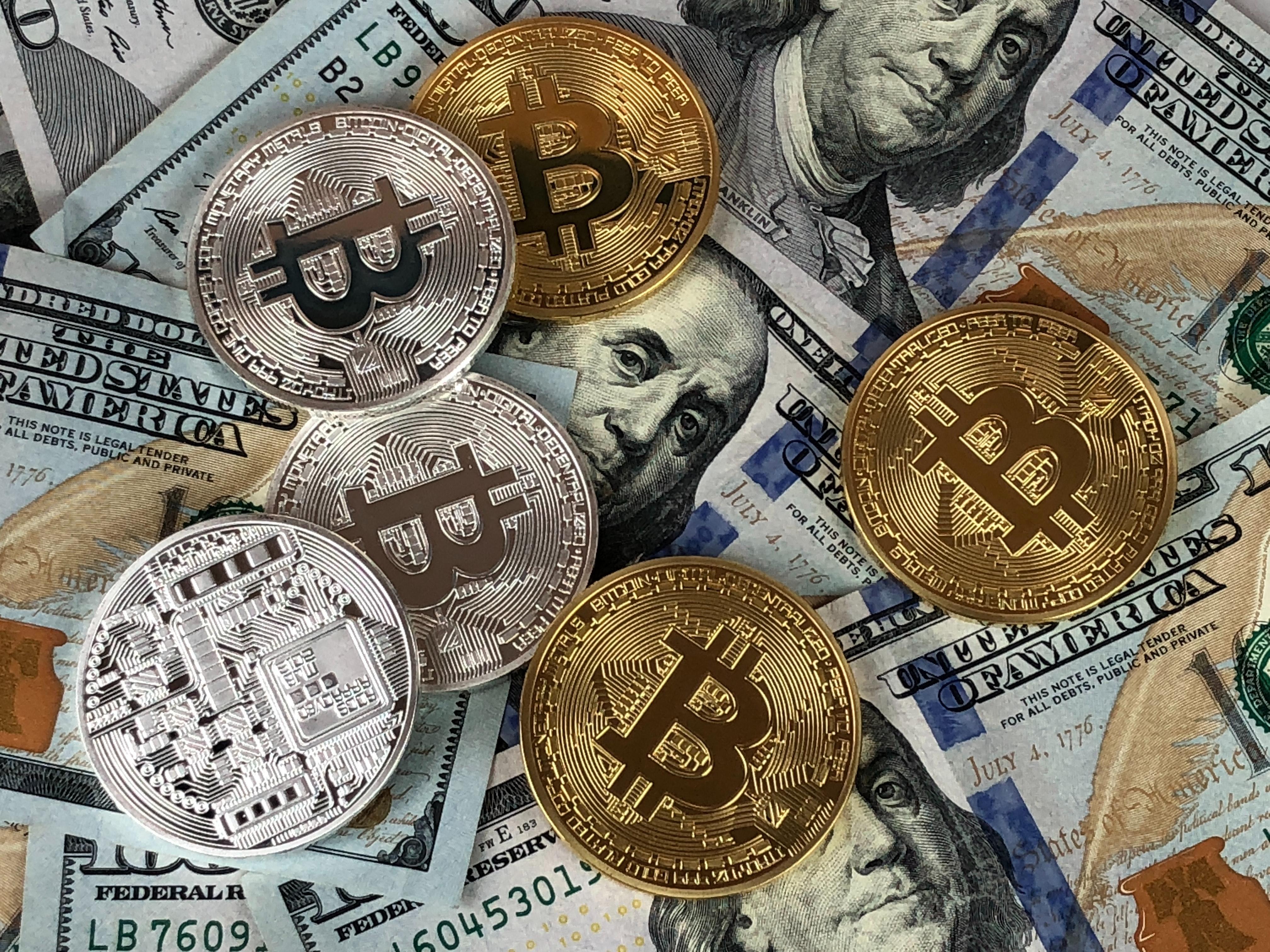 dollar notes with bitcoin ontop